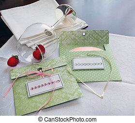 Envelopes for disks. white napkins and wine glasses