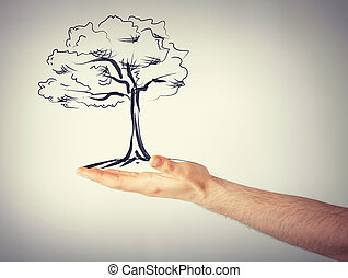 man with small tree in his hand