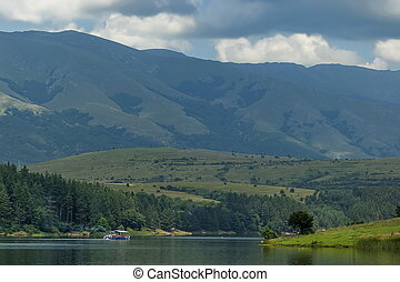 Environment of the dam, reservoir or barrage Dushantsi at river Topolnitsa with passenger-ship, Central Balkan mountain, Stara Planina, Bulgaria