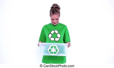 Environmental activist holding plastic box on white...