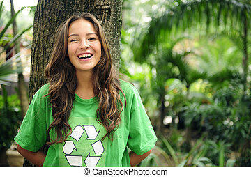 environmental activist in the forest wearing recycle t-shirt...