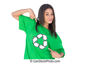 Environmental activist pointing to the symbol on her tshirt ...
