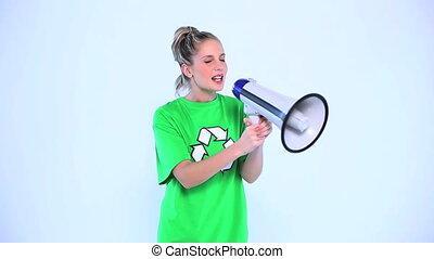 Environmental activist screaming in megaphone -...