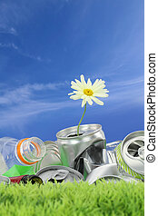 Environmental conservation concept. Garbage with growing daisy
