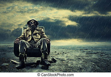 A lonely hero wearing gas mask sitting on armchair