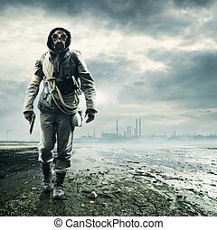 Environmental disaster. Post apocalyptic survivor in gas...