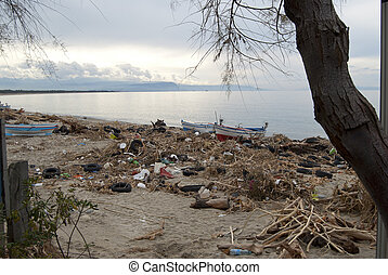 environmental pollution. A beach oh the Calabria with waste and polluting material