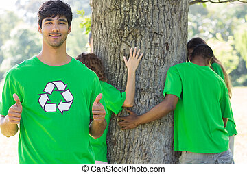 Environmentalist gesturing thumbs up in park