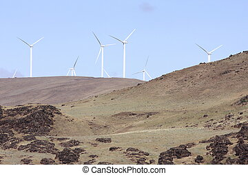 Environmentally friendly power source using wind farms.