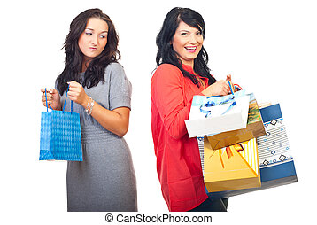Envy woman - Envious woman on her friend with many shopping...
