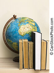 eographic globe and books on the table