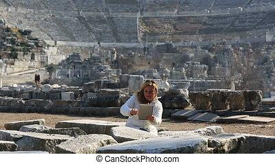 Ephesus Ancient City - attractive blonde tourist taking...
