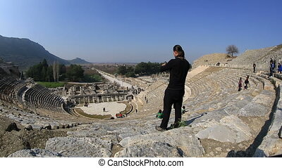 Ephesus Ancient City - tourist taking photo with digital...