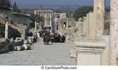 Ephesus Ancient City - tourists visiting columns street...