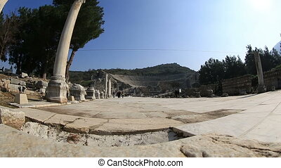 Ephesus Ancient City - tourists visiting ruins amphitheater...