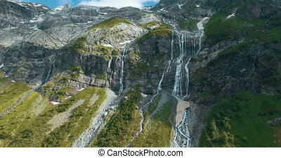 Epic aerial close up of waterfall in beautiful mountains in...