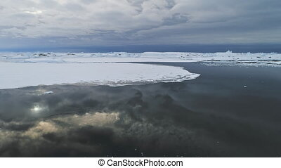Epic Antarctica Open Water Seascape Aerial View. Majestic Polar Iceberg Ocean Surface Environment Global Warming Concept. Harsh North Arctic Floe Wildlife Climate Overview Footage 4K (UHD)