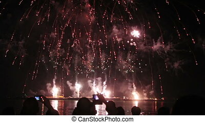 epic fireworks from boats on sea