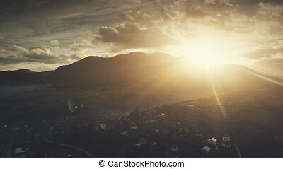 Epic sunrise flare mountain village aerial view - Epic...