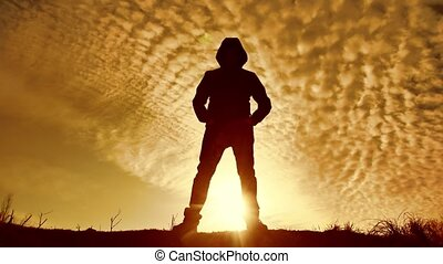 Epic unknown man silhouette at sunset bandit the criminal in...