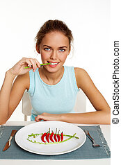 Portrait of pretty young girl eating gourmet dish