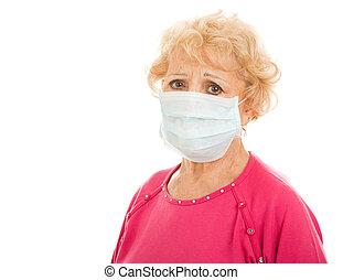 Epidemic - Senior Woman - Senior woman wearing a surgical...