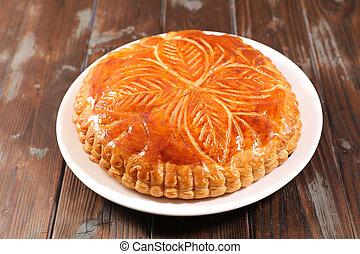 epiphany cake on wood background
