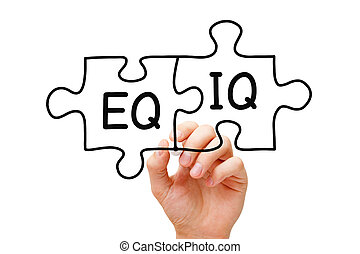 EQ And IQ Jigsaw Puzzle Concept - Hand writing EQ and IQ on ...