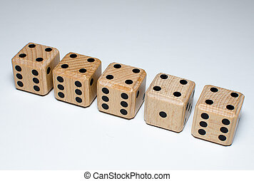 Equality - line of nearly equal wooden dice