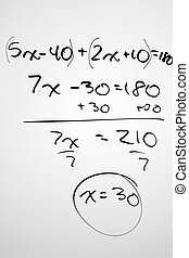 Solved Math equation written on a white board.