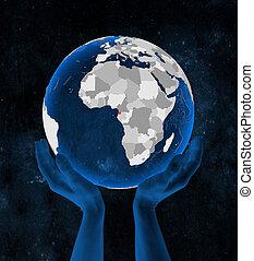 Equatorial Guinea on globe in hands - Equatorial Guinea on ...