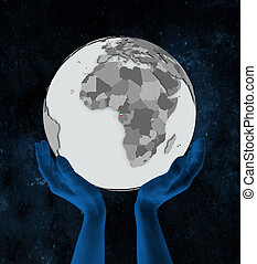 Equatorial Guinea on globe in hands - Equatorial Guinea with...