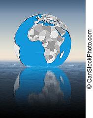 Equatorial Guinea on globe in water