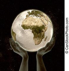 Equatorial Guinea on globe win hands