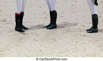 Equestrian riders on the show jumping competition, telephoto...