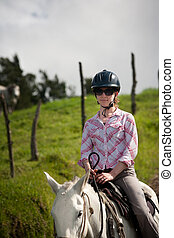 Equestrian Woman - Equestrian woman on horses ranch in Costa...