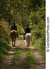 Equestrians - Two young riding ladies