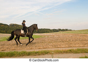 Equestrienne and a horse. - Equestrienne rides on a horse at...