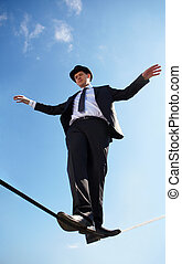 Equilibrium - Photo of skilled businessman walking down...