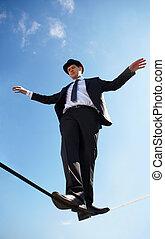 Equilibrium - Photo of skilled businessman walking down...