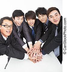 equipe affaires, à, main, ensemble, table