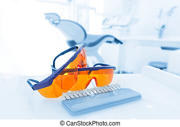 Equipment and dental instruments in dentist's office. Googles