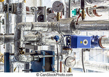 Equipment, cables and piping as found inside of a industrial workshop