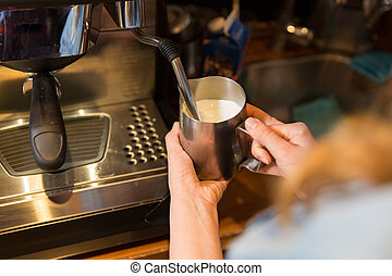 close up of woman making coffee by machine at cafe - ...