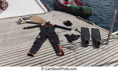 Equipment diver on ship near water in Red Sea.