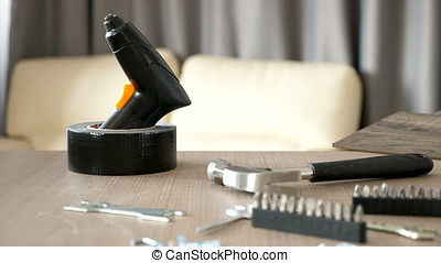 Equipment for furniture assembling on a table in living room