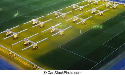 Equipment for illumination of grass stand on field of stadium