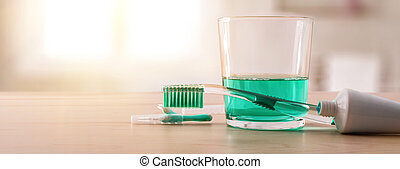 Equipment for oral hygiene on wood table in bathroom...