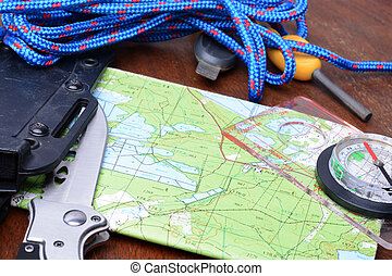 Equipment for survival. Map, knife, rope, compass, fire...