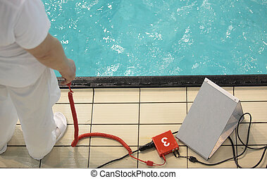Equipment for measuring time during swimming competitions